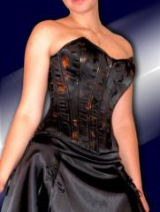 Corset from the black imprinted atlas with gold