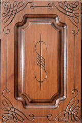 Furniture facades with a carving