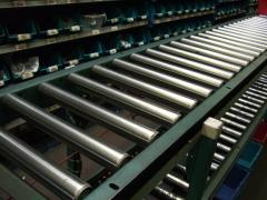 Tapes and rollers conveyor