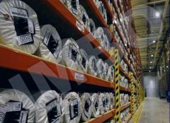 Storage racks for storage of rolls of fabrics