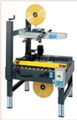 Машини для заклеювання картонних коробів