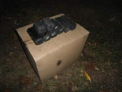 Briquette coal packed up in cardboard boxes