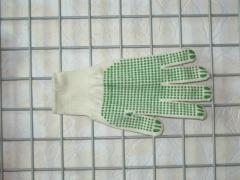 Gloves knitted with PVC poin