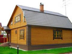 Siding blockhouse from pine - frame house Ukraine.