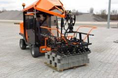 The laying of paving slabs, paving (Mechanized)