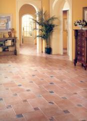 Tile ceramic for a floor