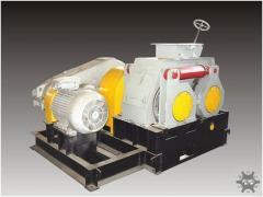 Roller briquetting press