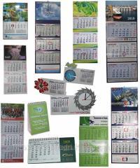 Календари настенные, квартальные, настольные,
