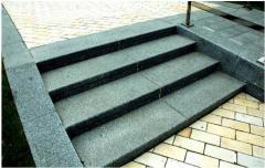 Borders sidewalk of granite