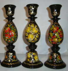 Candlesticks wooden with a decorative list.