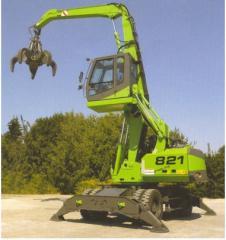 Loading cranes of scrap metal, grain, wood.