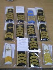 Shoulder straps, shirts, ties, embroidery for