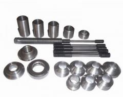 Set for spew/press fitting of guide bushings of