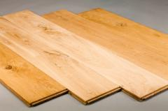 Parquet board from the massif of wood of an oak