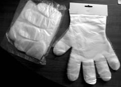 Plastic gloves on cardboard slip