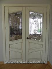 Doors from the massif of an oak balcony