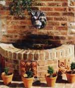 Стенные фонтаны эффектно смотрятся в окружении