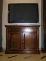 Bedside table under the TV to order