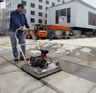 Watering machine on care of paving slabs of the