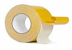 Adhesive tape on the fabric basis