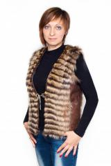 Vest from fur of a raccoon of a poloskun.