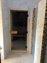 Door in a sauna from tinted glass