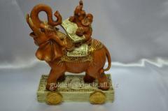 Figurine the Elephant on an elephant with money
