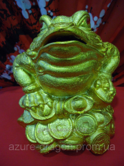 Moneybox the Toad under gold