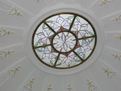 Ceiling stained-glass window with illumination