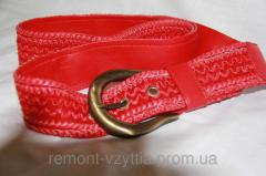 Red women's belt from the producer