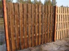Wooden fences from not cut board in Kharkiv and