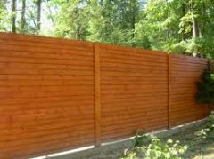 Fences wooden continuous in Kharkiv (under the