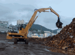 Loading crane for transfer of scrap, the wood and