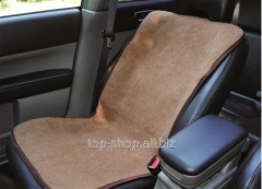 Cape on automobile seat from camel wool