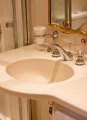 Wash basins from an artificial stone, for