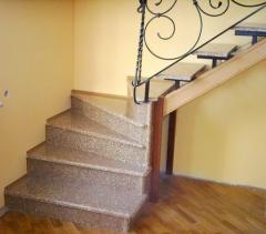 Steps for ladders from an artificial stone in