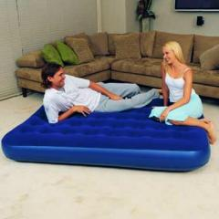 One-and-a-half inflatable mattress bed with a