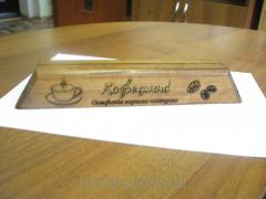 The menu holder on a wooden suppor