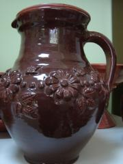 Potter's jug with a cover.