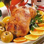 Утка запеченная с апельсином, яблоками и медом