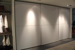 Coplanar sliding systems for sliding wardrobes in