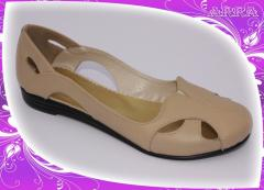 Beige flats from genuine leather