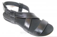 Sandals female leather on a flat sole