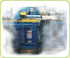 Automatic feeder of preparations to a press of