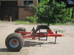 The cart under a spreader of mineral fertilizers