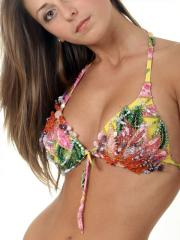 The bathing suits embroidered by beads, pastes and