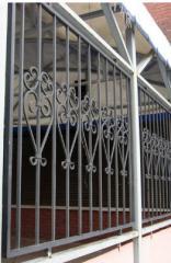 Решетки для дверных и оконных проемов кованые.