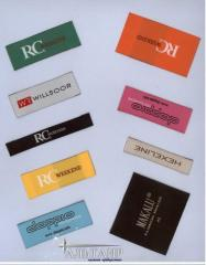 Labels sewn in in clothes and upholstered