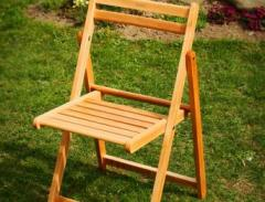 The chair is wooden folding