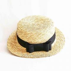 Hat of a boater with a bow